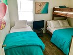 Bedroom 2 with bunk bed and twin bed