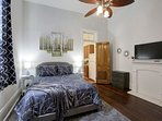 Cool the room with the ceiling fan before crawling into the queen-sized bed.