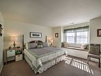 The king-sized master bedroom has a comfy king bed