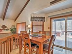 The raised dining area faces the covered patio accessible through the large sliding glass doors.