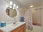 Freshen up in this full bathroom that provides a shower/tub combo.