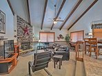 Cathedral ceilings lined with exposed beams frame this spacious living area.