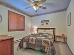 Two travelers will be able to rest easy on this queen bed in the second bedroom.