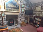 Sitting Room, with electric log burning stove.