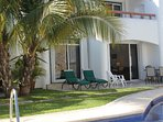 The large, fully furnished patio is steps from the pool.  Webber gas grill, sun loungers