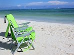 These portable beach chairs are provided for you to enjoy at this local beach - also beach towels