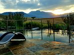 A view from your private eco swimming pond at sunset.