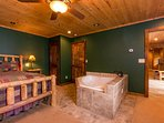 Knotty Pine Suite King bed & private massage tub