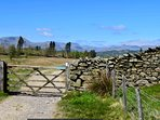 Views from across the village tarns to the Langdales