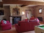 Salon with pool table, log burning stove , large wall mounted TV ,  piano, music system.