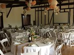 Function room set up for wedding  reception meal . Cinema room below is used for evening  dancing !