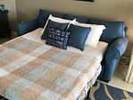 Queen sleeper sofa with upgraded mattress.