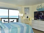 Master Bedroom – Spacious queen with direct access to patio and ocean views.
