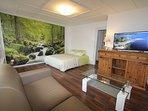 La vaste chambre dans une ambiance nature et zen