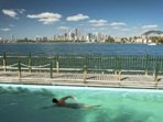 Enjoy the out door salt water swimming pool meters from the apartment