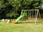 Couetilliec Cottages: play time for the little ones; swing set with slide and seesaw