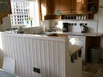 Well equipped kitchen with dishwasher. Washing machine and tumble dryer in attached utility area.