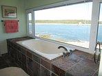 Enjoy soaking in a relaxing bath while enjoying the ocean view