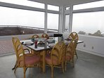 Dining area at Hella's Point surrounded by ocean views