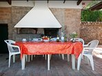 the patio where enjoy open air meals. Private use of barbecue and oven for pizza, with free firewood