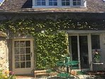 Cottage facade for coffee in the sunshine