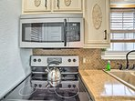 Stainless steel appliances fill the kitchen.