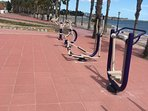 Fitness machines on beach promenade