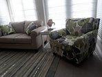 Comfortable living room facing the granite kitchen island.