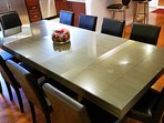 New oversized dining table seats 10-12. Additional 4 seats at the island.