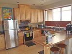 Spacious and furnished kitchen with stainless appliances.
