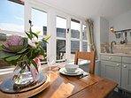 First floor kitchen/diner with garden view