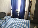 Second bedroom  accessible to separate bathroom . Air con , fly screen and security on windows.