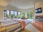 Wake up to lush landscape views in this king master suite.