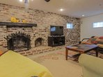 The family-friendly basement features two futons, a large screen TV, fireplace and ample room for your kids to play.