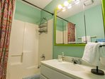 The bathroom features a combined tub & shower and lots of room to store your personal belongings.