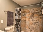 The bathroom is equipped with a lavish shower/tub combo.