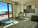 Open plan lounge/kitchen/diner with sofa bed