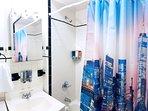 New York City-themed 2nd bathroom with bath tub