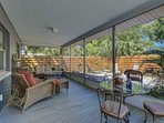 Enjoy an evening meal or glass of wine in your large screened-in lanai.  Plenty of space for family, friends and Fido!