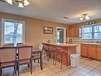 The fully equipped kitchen opens to a nice dining area.