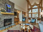Sink into the sofa and admire the stone fireplace.