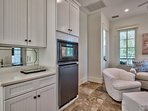 The second floor family room has a kitchenette with a mini fridge and microwave.