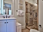 The second Master Bathroom also features a spacious walk-in shower.
