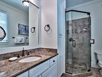Inside the Master Bathroom, you'll find a walk-in shower and stand-alone tub.