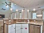 Pendant lighting provides a nice touch over the kitchen breakfast bar.
