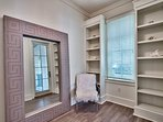 Enjoy getting ready in the Master Bedroom's dressing area, which has a floor-length mirror.f
