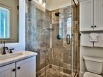This bathroom contains a walk-in shower.