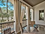 Enjoy the natural landscape from the patio, where you'll find outdoor dining for four and a gas grill just down the...