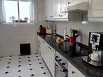 Fully fitted kitchen with coffee maker, dishwasher and there is a utility room with washing machine