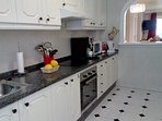 Fully fitted kitchen with serving hatch to dining area